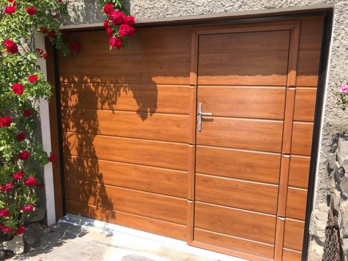 Installation de porte de garage sectionnelle volets for Porte de garage pvc imitation bois